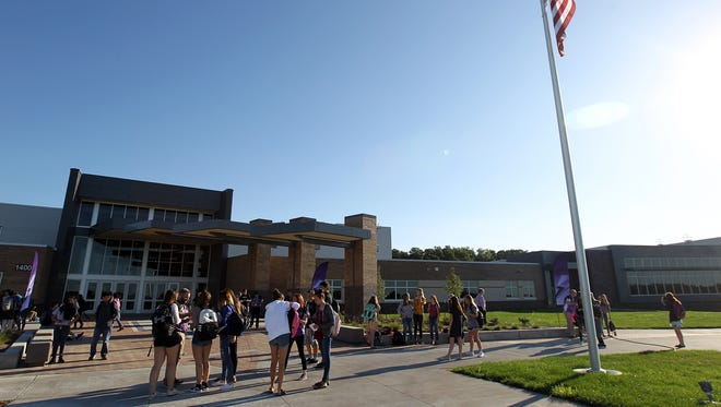 Liberty High students gather on the first day of school in North Liberty on Wednesday, Aug. 23, 2017.