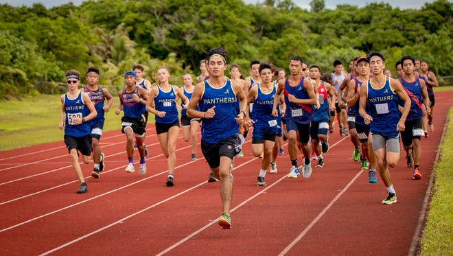 In this photo of their head-to-head matchup August 24, Guam High School and Okkodo High School take off for their dual meet. The Panthers finished with a perfect 10-0 season, and the Okkodo Bulldogs took second at the regular-season finales on Monday.