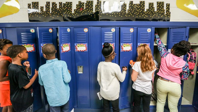 Fourth grade students go to their locker in between classes at Madison Elementary School in Madison Heights, Mich. on Monday, Aug. 28, 2017. The school district saw great improvement on the M-STEP this spring.