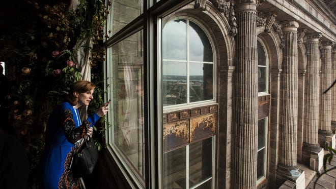 Lisa Pollina of Chicago, IL looks out at the view of Detroit from the 13th floor of Michigan Central Station in Detroit on Wednesday September 13, 2017 during Crain's Detroit Homecoming IV event.
