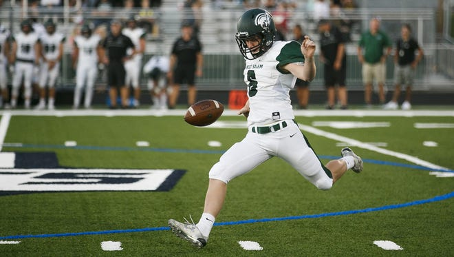 West Salem's Andrew Bartholomew punts the ball in the opening game of the season at McKay High School on Friday, Sept. 1, 2017, in Salem, Ore. West Salem went on to win the game 35-15.