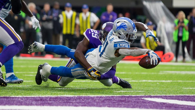 Lions running back Ameer Abdullah scores a 3-yard touchdown in the third quarter against the Vikings on Oct. 1 in Minneapolis.
