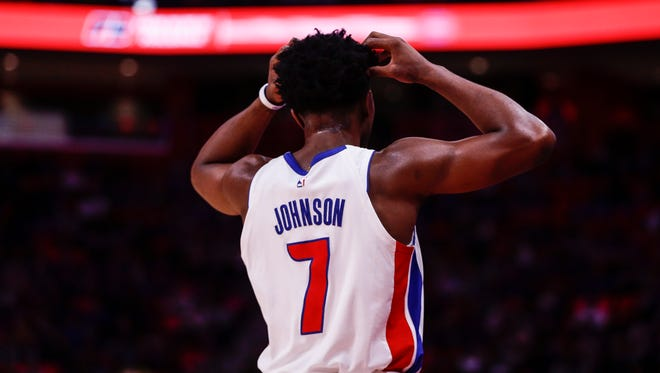 Stanley Johnson scratches his head after missing a jump shot during the second quarter of the Pistons' 102-90 win over the Hornets at Little Caesars Arena on Wednesday.