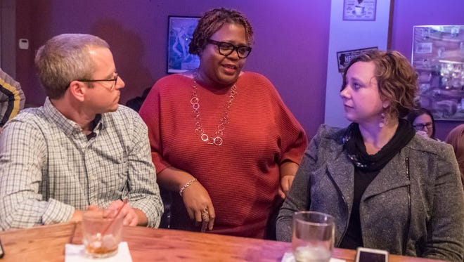 City commission candidates, from left: Dan Boyd, Lynn Ward Gray and Kaytee Faris, wait for election results Tuesday evening.