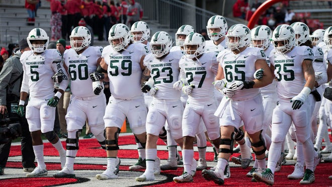 Nov 11, 2017; Columbus, OH, USA; The Michigan State Spartans take the field to warm up before the game against the Ohio State Buckeyes at Ohio Stadium.