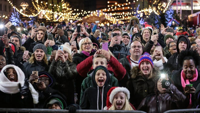 The crowd cheers as the tree is lit during the 2017 Detroit Tree Lighting Ceremony at Campus Martius Park in downtown Detroit on Friday, November 17, 2017.