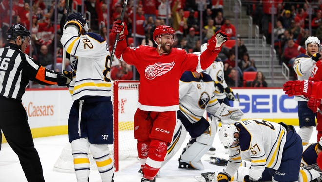 Red Wings right wing Luke Glendening (41) celebrates after scoring a goal on Sabres goalie Robin Lehner (40) during the second period of the Wings' 3-1 win on Friday, Nov. 17, 2017, at Little Caesars Arena.