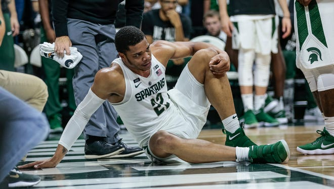 Michigan State's Miles Bridges (22) tries to stand up after falling on the court during the second half of MSU's 93-71 win over Stony Brook on Sunday, Nov. 19, 2017, at Breslin Center.