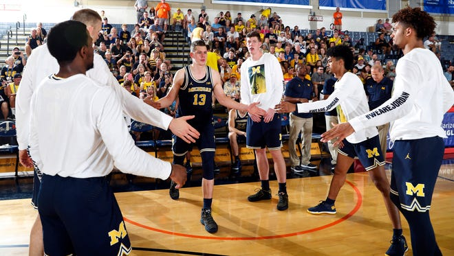 Michigan forward Moe Wagner is introduced before the game against Chaminade on Tuesday.