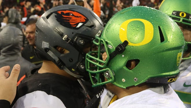 Oregon State and Oregon players congratulate each other on the field following the Oregon vs. Oregon State Civil War football game at Oregon State University in Corvallis on Saturday, Nov. 26, 2016. The Beavers won the game 34-24.