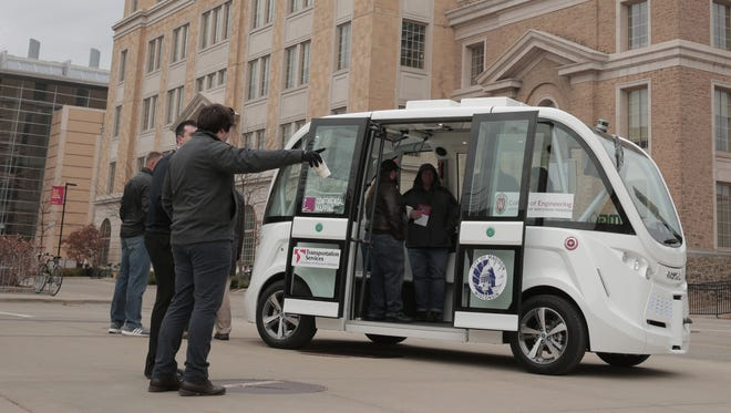 A French driverless passenger shuttle is on display at the University of Wisconsin-Madison in November. The U.S. Department of Transportation this year named UW-Madison one of 10 pilot sites to encourage testing and information sharing involving automated vehicle technology.