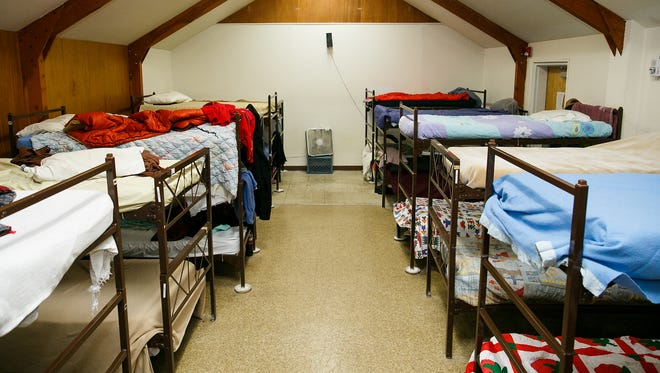The top bunks are back in dorms at Union Gospel Mission after the organization lobbied city fire officials to increase the shelter's capacity.