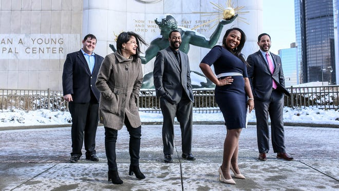 Kevin Tatulyan, 28, of West Bloomfield; Gabriela Santiago-Romero, 25, of Detroit; Moreno Taylor II, 34, of Lansing; Taylor Harrell, 24, of Detroit and Rico Razo, 33, of Detroit are all future political leaders photographed in front of the Spirit of Detroit in downtown Detroit on Tuesday, Dec. 12, 2017.