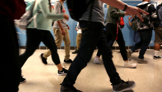 Students walk through the halls at a Salem-Keizer high school.