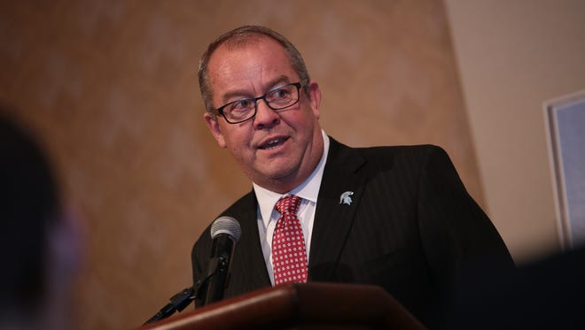 Michigan State University athletic director Mark Hollis, the winner of Distinguished American award, speaks to the crowd during the 2015 Detroit Free Press Football Awards Banquet on Sunday, Dec. 13, 2015, in Dearborn