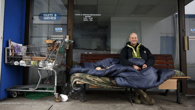 Robin Corey sits on a bench in Salem on Jan. 31, 2018, as part of the point in time homeless count.