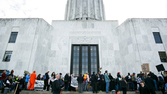 Crowd members listen to activists and lawmakers speak at a rally against offshore drilling on Tuesday, Feb. 6, 2018, at the Oregon State Capitol. Several hundred people showed up to demonstrate before a Bureau of Ocean Energy Management hearing on a proposal to open Oregon's coast to oil and gas drilling.