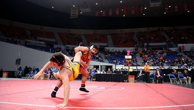 Sprague's Santos Cantu III, top, and Newberg's Hunter James compete in the OSAA Wrestling State Championships Class 6A final for weight 195 at Veterans Memorial Coliseum in Portland on Saturday, Feb. 17, 2018.