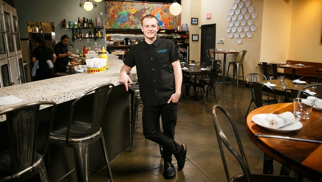 Ryan Toepfer in the dining room of Portland restaurant Ataula, where he works as a chef du partie, on Thursday, Feb. 22, 2018. Toepfer graduated from South Salem High School in 2012 and will soon be working at San Francisco restaurant Quince, which is one of 14 U.S. restaurants with three Michelin stars, as a junior sous chef.