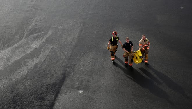 Salem firefighters go through training exercises at the Salem Fire Training and Emergency Medical Services in Salem on Thursday, March 1, 2018.