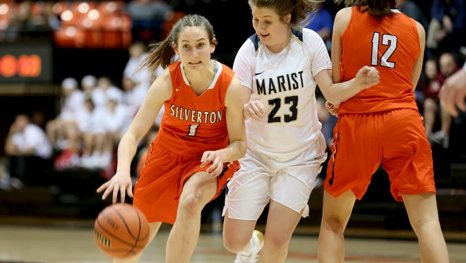 Silverton's Jori Paradis (1) drives through Marist Catholic's Emma McKenney (23) and teammate Brooke McCarty (12) in the first half of the Silverton vs. Marist Catholic OSAA Class 5A semifinal girls basketball game at Oregon State University in Corvallis on Thursday, March 8, 2018. Marist Catholic won the game 46-39. Silverton will go on to play in the third place game on Friday.