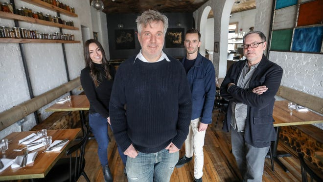 Meg Janott, head of design, from left, Toby Barlow, creative chief, Ben Bator, chief innovation officer, and Doug Patterson, creative director, are starting a new marketing firm together called Lafayette American and are photographed at Gold Cash Gold restaurant, where Barlow is a partner, on March 9, 2018.