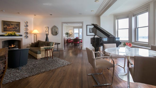 The open floor plan takes in a living room that's 31 feet long and the dining room behind that's 21 feet. The big bay window overlooks the Detroit River and Belle Isle.