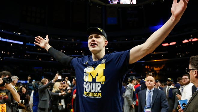 Moritz Wagner waves at the crowd after Michigan defeated Florida State, 58-54, in the Elite Eight of the NCAA tournament at Staples Center in Los Angeles, Saturday, March 24, 2018.