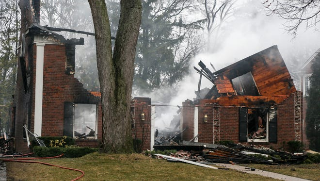 Three homes on Washington road in Grosse Pointe are still smoldering after an overnight fire that destroyed them, photographed on March 27, 2018.