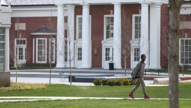 A student walks on the DePauw University campus on April 18, 2018, a day after about 100 students of color interrupted an appearance by actress Jenna Fischer to protest recent incidents of racism at the Greencastle, Ind., school.