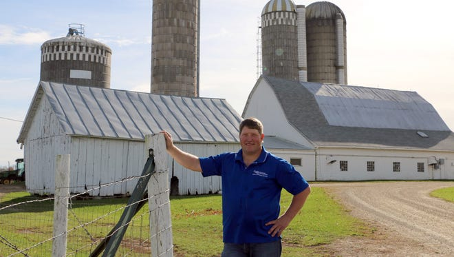 Wisconsin Farmers Union President Darin Von Ruden stands on his third-generation family dairy farm near Westby.