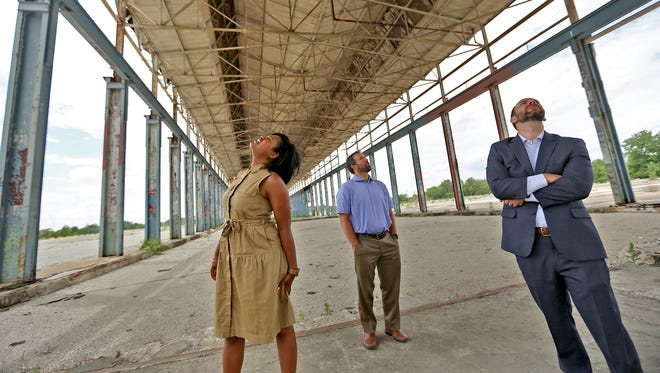 Ambrose Property Group Director of Marketing and Community Initiatives Mali Jeffers , from left, Vice President Andrew Greenwood, and Ambrose Executive Vice President Patrick Chittenden visit the old GM stamping plant site, Tuesday, May 15, 2018.  Ambrose Property Group is the new owner of the site.
