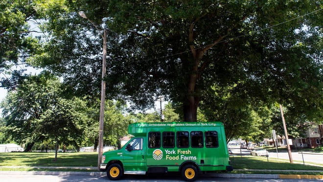 York Fresh Food Farms' new van sits at the intersection of Pershing Ave and Parkway Boulevard on Saturday, June 16, 2018. York Fresh Food Farms' new van allows the farm to sell its produce and fruits at different stops throughout York.
