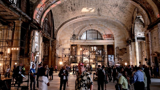 People see the inside of Michigan Central Station during the celebration of Ford Motor Company buying the Michigan Central Station in Corktown, a Detroit neighborhood, on Tuesday, June 19, 2018.