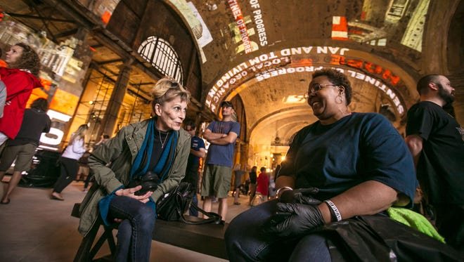 Fran Nivison, left, of Harper Woods and Monique Thomas of Detroit share a laugh while taking a break inside Michigan Central Station in Detroit during an open house put on by Ford Motor Company on Friday, June 22, 2018.