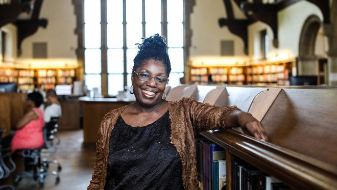 Disa Bryant, 51, of Detroit lost her home due to foreclosure for unpaid property taxes and found herself homeless in 2016, but thanks to the quick thinking of a librarian at her nieghborood library, Parkman Branch, she was able to apply for a grant that would help her find a new place to stay. Bryant is photographed at the library on Wednesday, June 20, 2018,