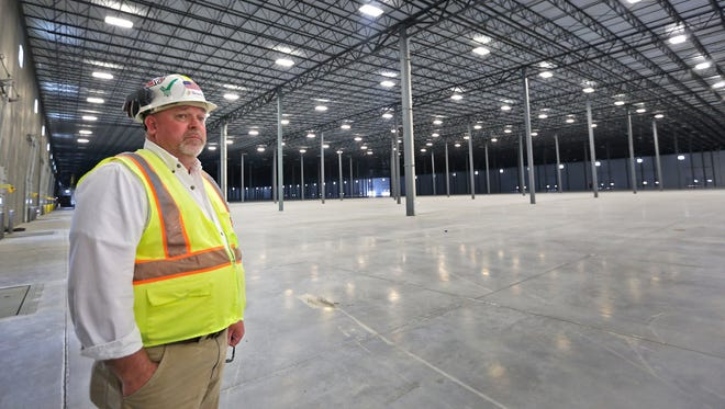 Ken Carnagua, on-site superintendent with Browning Investments, shows Building 6 at AllPoints Midwest Industrial Park in Plainfield on Wednesday, April 15, 2015. Construction of the 936,510-square-foot warehouse began last summer and is scheduled to be completed by May.