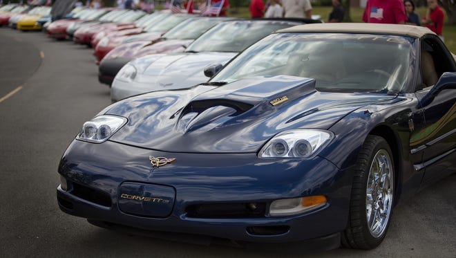 Corvettes in the Corvette Indy club wait for the Fishers Freedom Festival parade to begin on June 30, 2013, in Fishers.