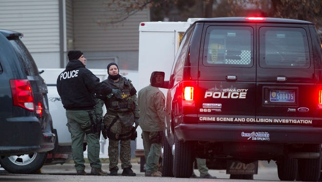 Police officers pack up after taking Lorenzo Jones into custody outside an apartment complex on Benton Drive Monday.