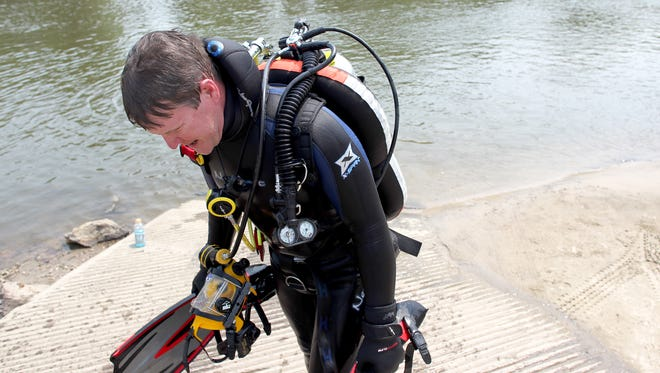 Jeff Morris volunteered his time to help with training in the Johnson County Metro Dive Team at Sturgis Landing in Iowa City on Sunday, August 11, 2013.