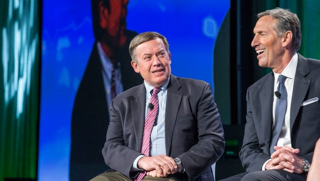 Arizona State University President Michael Crow, left, and Starbucks Chairman and CEO Howard Schultz discuss the expansion of an educational partnership that gives Starbucks employees free tuition reimbursement for taking online classes through ASU.