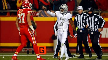 Dec 8, 2016; Kansas City, MO, USA;  Oakland Raiders punter Marquette King (7) points at Kansas City Chiefs tight end Travis Kelce (87) after a Chiefs touchdown during the first half at Arrowhead Stadium. Mandatory Credit: Jay Biggerstaff-USA TODAY Sports