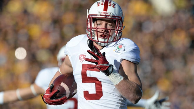 Jan 1, 2016; Pasadena, CA, USA; Stanford Cardinal running back Christian McCaffrey (5) runs for a touchdown against the Iowa Hawkeyes during the first quarter in the 2016 Rose Bowl at Rose Bowl. Mandatory Credit: Richard Mackson-USA TODAY Sports