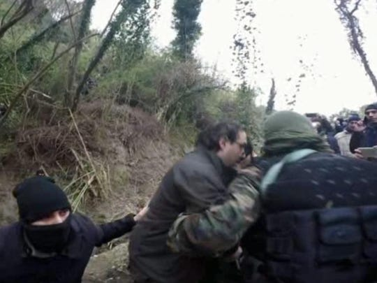 Italian police arrest two top fugitive members of the