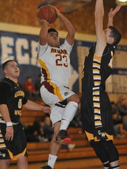 Tulare Union's Stevin Morin shoots against Golden West
