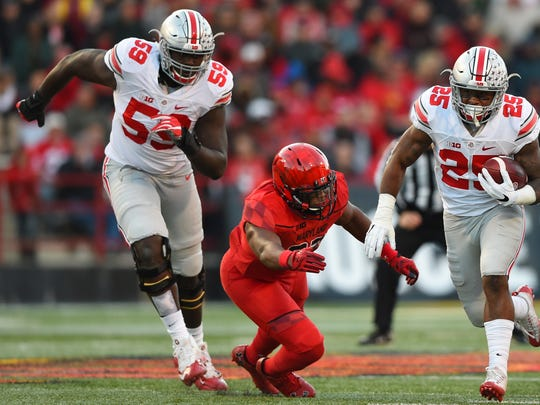 Ohio State running back Mike Weber scoots past Maryland linebacker Jermaine Carter in the first half of Saturday's game.