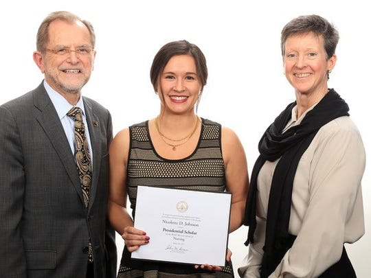 Nicolette Johnson is a 2011 Harper Creek High School graduate. Pictured with her: WMU President John Dunn and WMU Faculty Senate President Suzan Ayers.