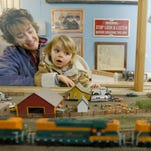 Christine Ward holds her granddaughter, Gemma Moore, 3, so she can get a better look of an HO scale model train going by during the Great Falls Model Railroad Club's Christmas Fun Run at the Montana ExpoPark last year.