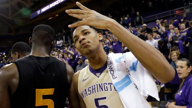 Washington's Dejounte Murray celebrates after a game against Arizona State on Feb. 3, 2016, in Seattle.