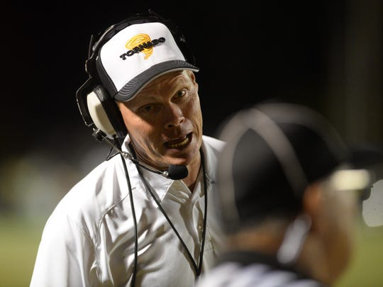 Haynesville head coach David Franklin argues a call with the referee during his game against Homer earlier this season.